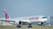 Qatar Airways to cut jobs and pilot salaries