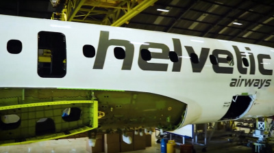 Video: First Helvetic Embraer E190E2 leaves paint shop