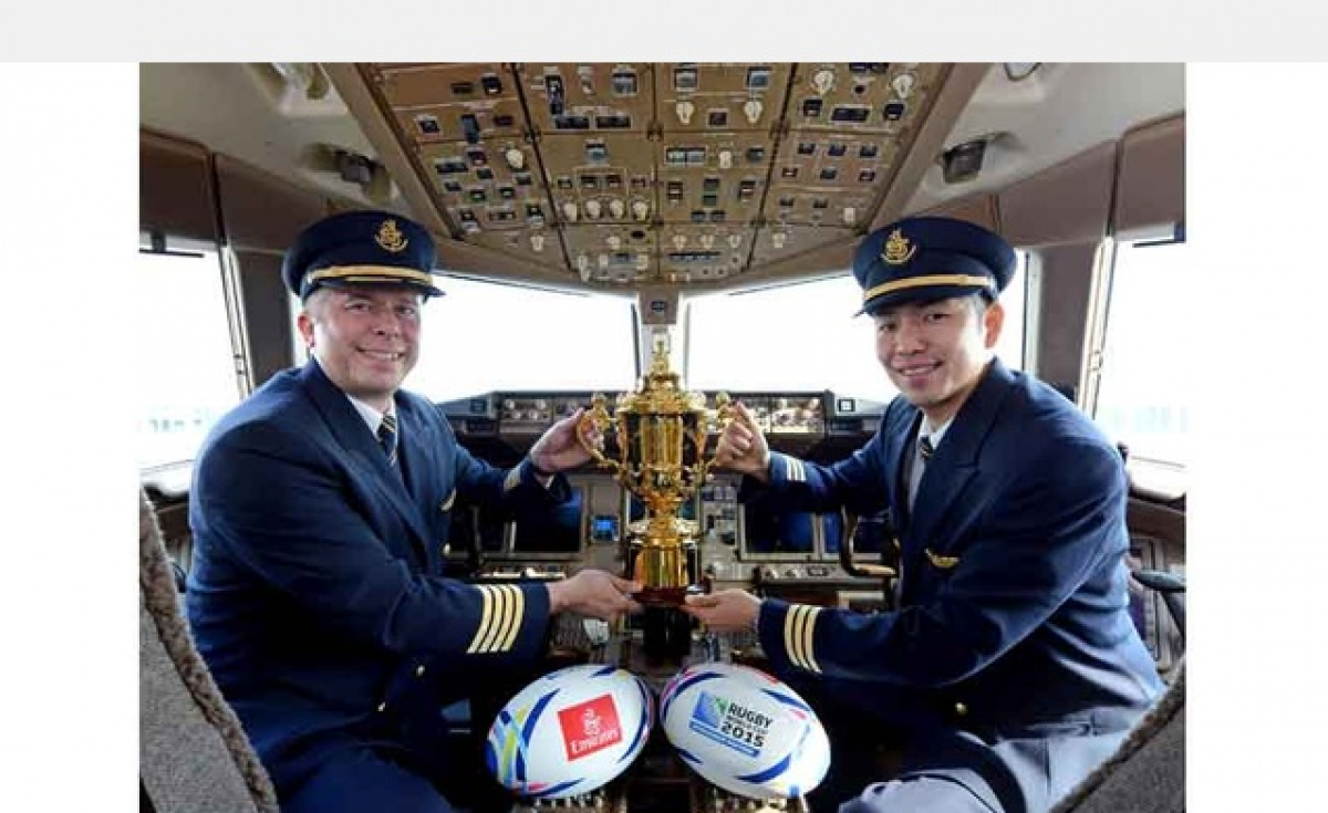 Emirates Captain, Jason Scattergood (England) and Emirates First Officer, Tomohisa Kitano (Japan), with the Web Ellis Cup which is awarded to the winner of the RWC.