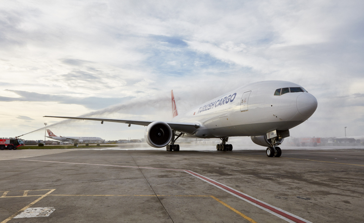 Boeing [NYSE:BA] and Turkish Airlines announced that the carrier ordered three more 777 Freighters in December 2017. The new order came weeks after the carrier took delivery of two of the large cargo jets (seen here receiving a water canon salute) as part of its plan to further expand its freight business. (Turkish Airlines photo)