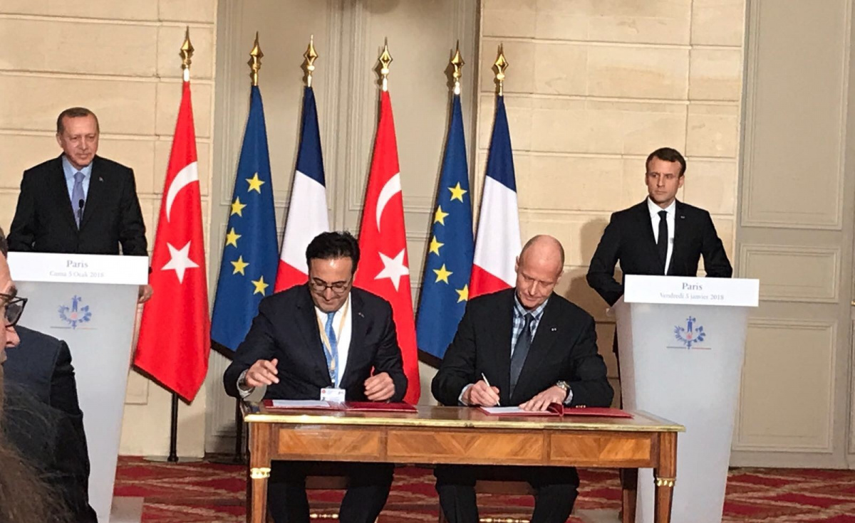 The agreement was signed at the at the Élysée Palace in Paris, in the presence of Turkish President Recep Tayyip Erdoğan and French President Emmanuel Macron.