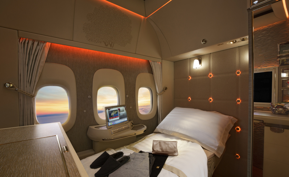 Emirates' fully enclosed First Class suites on the Boeing 777 feature floor to ceiling sliding doors and a novel design inspired by the Mercedes-Benz S-Class.