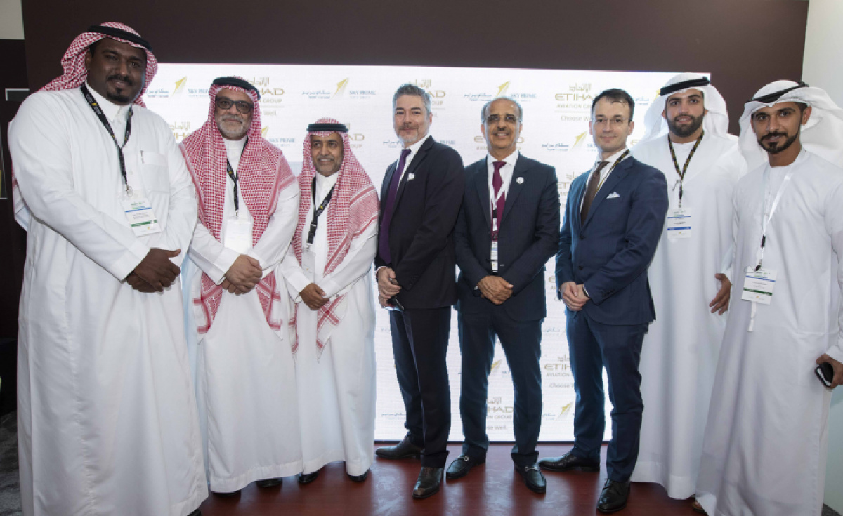 (L-R): Ibrahim Al Nwessr, Director of Maintenance part 121, Sky Prime, Captain Mamdooh Mokhtar, Chief Executive Officer, Sky Prime, Turki Al-Otaibi, VP Support Services and Sales, Sky Prime with Frederic Dupont, VP technical Sales and Customer Support, Etihad Airways Engineering, Abdul Khaliq Saeed, Chief Executive Officer, Etihad Airways Engineering and Etihad Airways Engineering's Customer Focus Team Roberto, Amer Almulla and Mohammed Alzaabi sign agreement with Sky Prime for MRO engineering services.