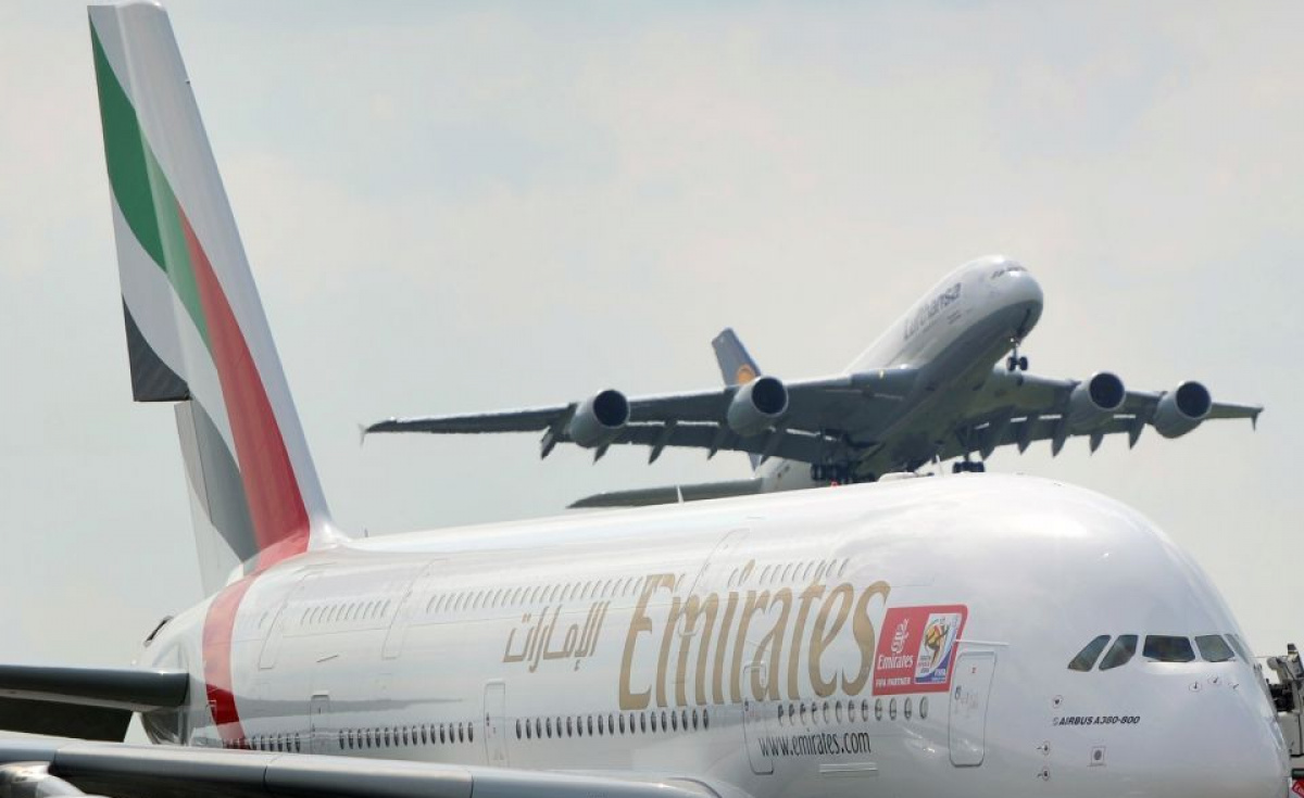 A Lufthansa A380 takes off over an Emirates Airlines A380 aircraft presented at the International Aerospace Exhibition ILA at the Schoenefeld airport in Berlin. The German carrier lobbyied of the German federal government over flying rights to the country.