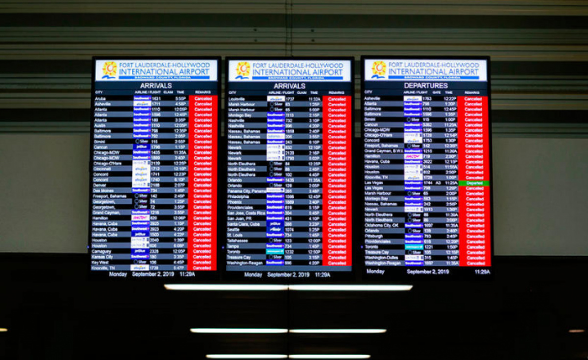 An information board displaying canceled flights is seen in the departure hall at Fort Lauderdale-Hollywood International Airport in Fort Lauderdale