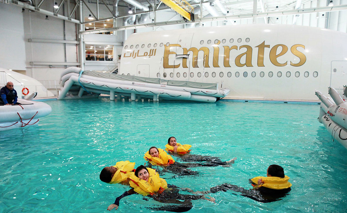 Emirates cabin crew trainees practise safety and emergency procedures