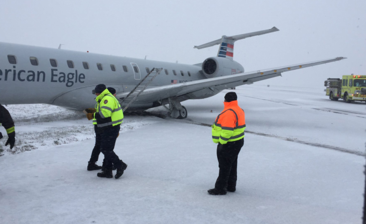 American Airlines flight on its side at O'Hare International airport after skidding from runway in icy conditions.