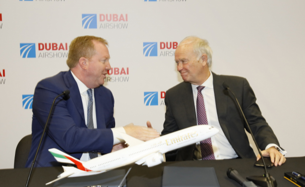 Stanley Deal, president of Boeing Commercial Airplanes and Sir Tim Clark, president of Emirates airline, shake on a deal for 30 787-9s.