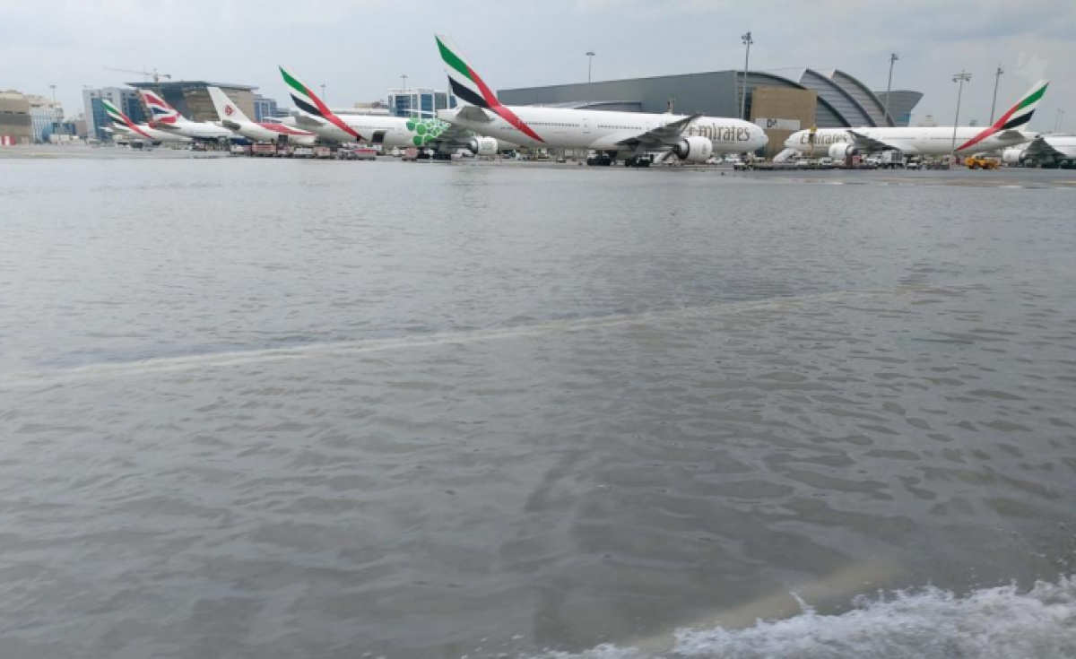 Parts of DXB's runway area were pictured submerged underwater.